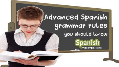 Student reading book on advanced spanish grammar rules